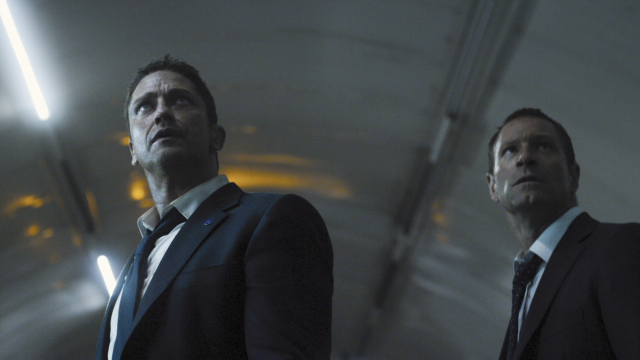 Gerard Butler and Aaron Eckhart take a moment to figure out why they agreed to make this movie. (Photo: Focus Features)