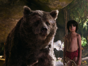 Mowgli (Neel Sethi) with Baloo (voiced by Bill Murray) in Disney's Jungle Book